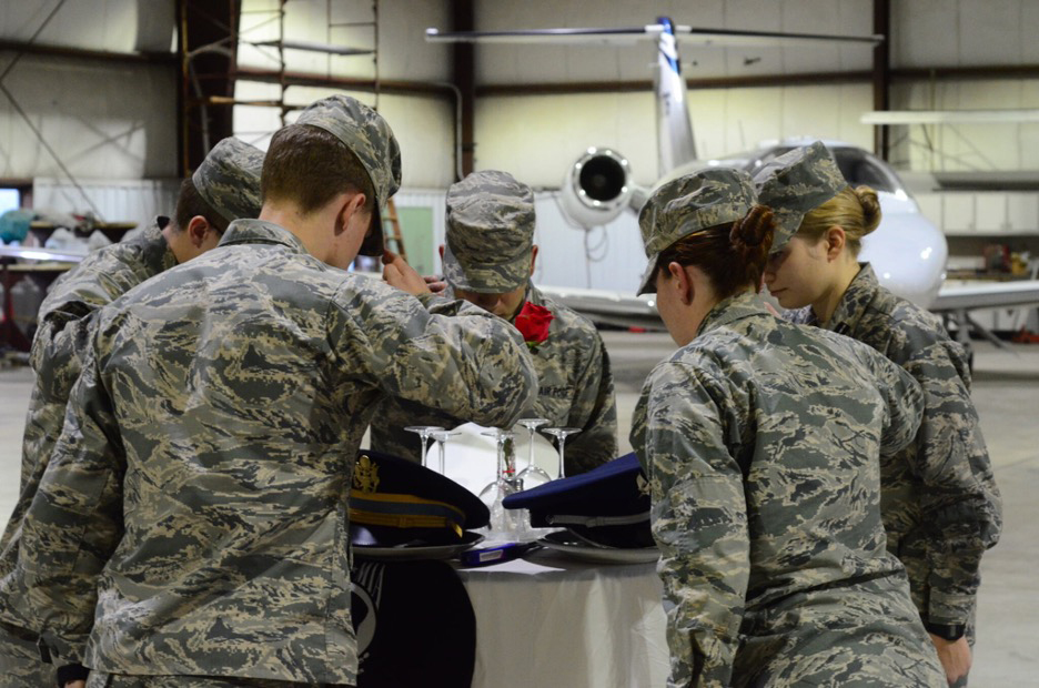 Cadets Saluting Empty Table